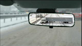 tractor trailer jack-knives on snowy freeway